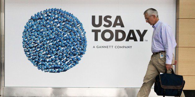 An unidentified man walks through the lobby of the Gannett-USA Today headquarters building August 20, 2013 on a 30-acre site