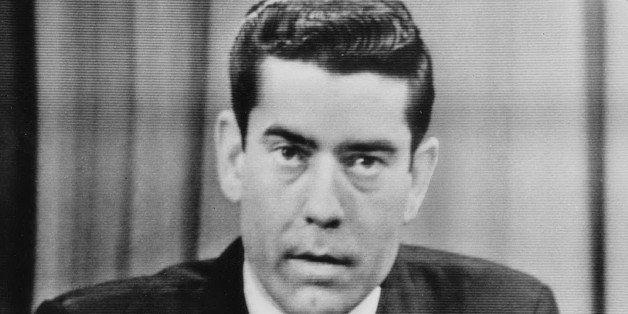 DALLAS - NOVEMBER 23: In this image shot of a television screen on November 23, 1963, Dan Rather reports from CBS television