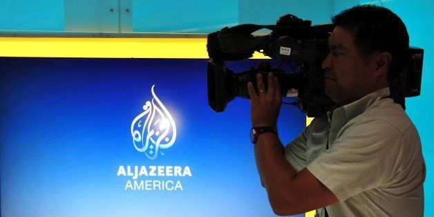 A television cameraman takes video of the new Al Jazeera America television broadcast studio on West 34th Street August 16, 2013 in New York. Al Jazeera America, which will launch on August 20, will have its headquarters in New York. AFP PHOTO/Stan HONDA (Photo credit should read STAN HONDA/AFP/Getty Images)