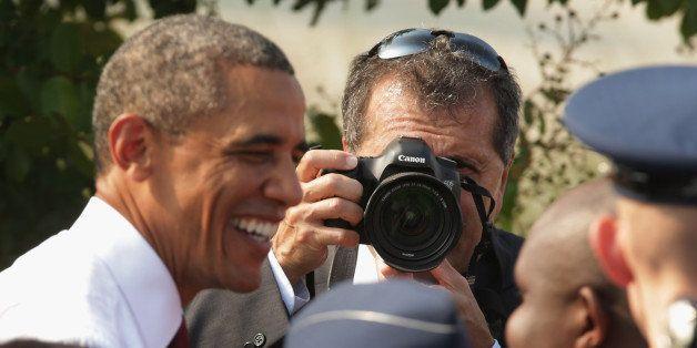 ARLINGTON, VA - SEPTEMBER 11:  As White House photographer Pete Souza makes images, U.S. President Barack Obama greets family
