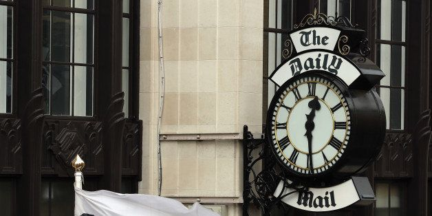 LONDON, ENGLAND - OCTOBER 04:  A general view of a clock on the side of Northcliffe House, where the offices of British newsp