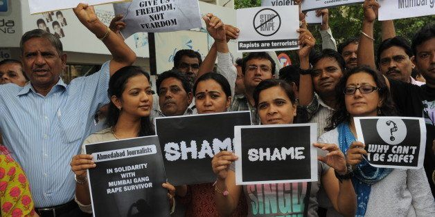 Indian journalists stage a protest against the gang-rape of a female colleague in Mumbai, at the Mahatma Gandhi Ashram in Ahm