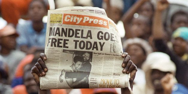 A jubilant Sowetan holds up 11 February 1990 in Soweto a newspaper announcing the release of anti-apartheid leader and Africa
