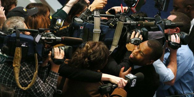 TORONTO, ON- NOVEMBER 13  -  A reporter is caught in the crush of cameras while trying to get comment from Toronto Mayor Rob