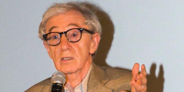 PARIS, FRANCE - AUGUST 27:  Director  Woody Allen speaks on stage during the Paris premiere of 'Blue Jasmine' at UGC Cine Cit