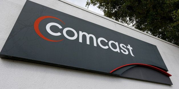 POMPANO BEACH, FL - FEBRUARY 13:  A Comcast sign is seen at one of their centers on February 13, 2014 in Pompano Beach, Flori
