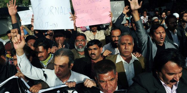 Pakistani journalists shout slogans against the killing of Wali Khan Babar, a reporter with a local television channel Geo Ne