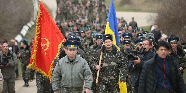 LUBIMOVKA, UKRAINE - MARCH 04:  Colonel Yuli Mamchor (L), commander of the Ukrainian military garrison at the Belbek airbase,