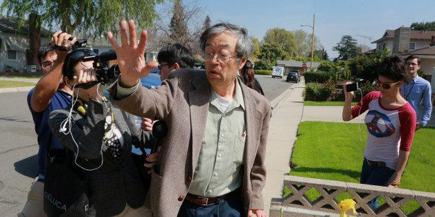 Dorian S. Nakamoto, identified by Newsweek magazine as the founder of Bitcoin, exits his home surrounded by members of the me