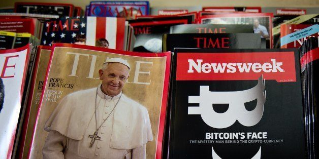 A copy of the new print edition of Newsweek magazine is diplayed in a newsstand in Washington on March 10, 2014. Newsweek, on