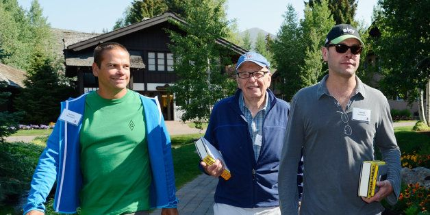 SUN VALLEY, ID - JULY 12: Lachlan Murdoch (L) and James Murdoch (R) with their father, Rupert Murdoch (C), Chairman and CEO o