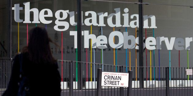 A woman walks past the offices of the Guardian newspaper in central London on August 20, 2013. The British government forced