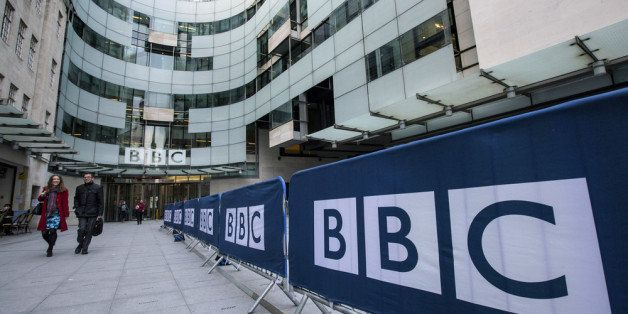 LONDON, ENGLAND - MARCH 25:  People walk past Broadcasting House, the headquarters of the BBC, on March 25, 2014 in London, E