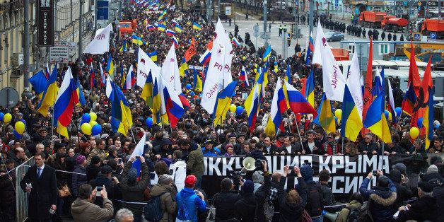 MOSCOW. RUSSIA - MARCH 15: Anti-Putin demonstrators carrying Russian and Ukrainian flags march to oppose president Vladimir P