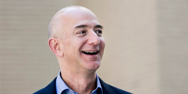 Jeff Bezos, founder and chief executive officer of Amazon Inc. and new owner of The Washington Post, leaves from the newspape