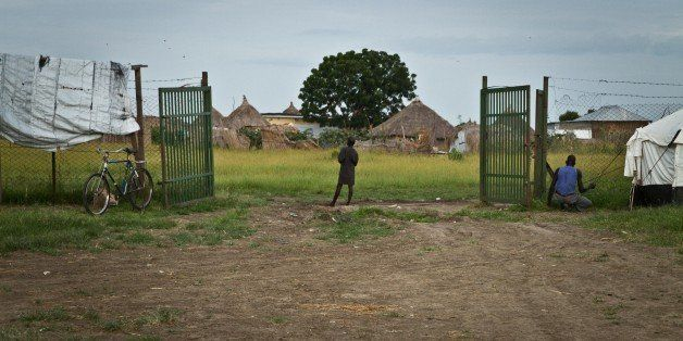 A returnee is standing at the entrance of Way Station in South Sudan's Upper Nile State Malakal on September 26, 2012. Malaka