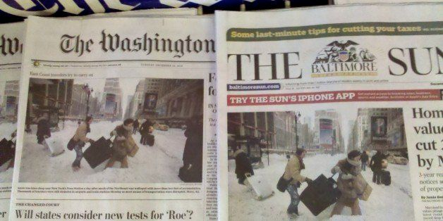Identical photos on the front pages of both the Washington Post and the Baltimore Sun