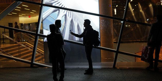 NEW YORK, NY - MAY 19: People walk the grounds at the Ground Zero memorial site after authorities recently took down gates and opened the plaza to the public on May 19, 2014 in New York City. Visitors previously had to wait in line to enter a barricaded area which includes the newly dedicated National September 11 Memorial Museum. Together with the museum, Ground Zero has become one of the top tourist attractions in the nation with tens of thousands of visitors expected yearly. The museum will open to the general public this Wednesday. (Photo by Spencer Platt/Getty Images)