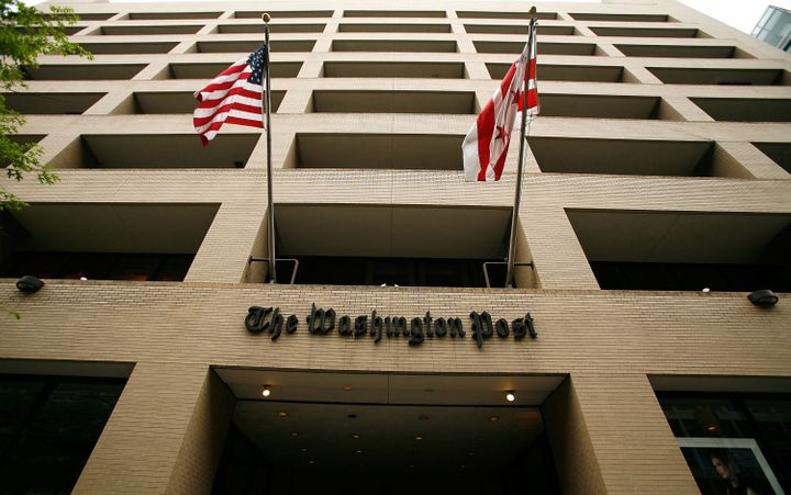 WASHINGTON - MAY 01: Flags wave in front of the Washington Post building on May 1, 2009 in Washington, DC. The newspaper has announced its first quarter earnings with a net loss of $19.5 million. (Photo by Alex Wong/Getty Images)