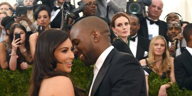Kanye West (R) and Kim Kardashian arrive at the Costume Institute Benefit at The Metropolitan Museum of Art May 5, 2014 in Ne