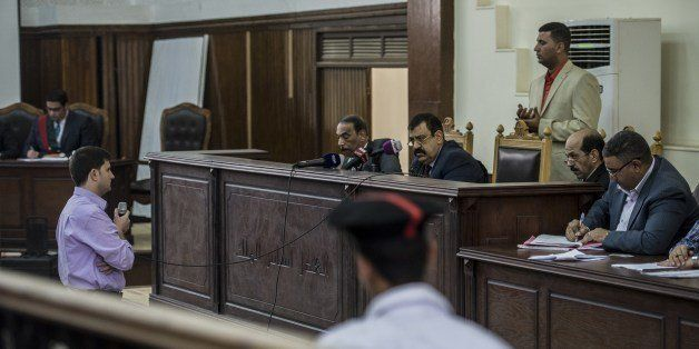 Egyptian Judge Mohame Shreen Fahmi (C) listens to a witness during the trial of Al-Jazeera channel's journalists for allegedl