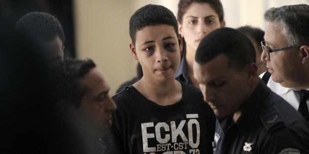 Tariq Abu Khder (C), a Palestinian-US teenager who was allegedly beaten during police custody, arrives for a hearing at Jerus