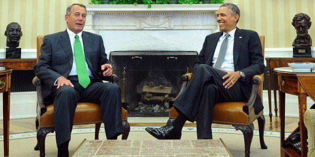 US President Barack Obama (R) meets Speaker John Boehner in the Oval Office at the White House in Washington, DC, on February