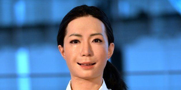 The new humanoid robot named 'Otonaroid' gestures during a press preview at the National Museum of Emerging Science and Techn