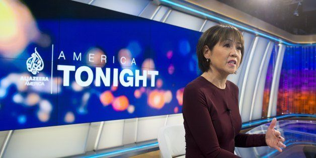 Joie Chen, host of the new Al Jazeera America nightly news program America Tonight, sits at the anchor desk in the network's