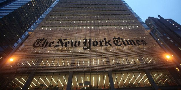 NEW YORK - DECEMBER 07:  The New York Times' masthead is displayed in front of the midtown headquarters on December 7, 2009 i
