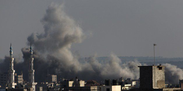 Smoke billows following an Israeli military strike on Gaza City on August 8, 2014. Israeli warplanes pounded targets across G