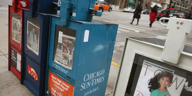 CHICAGO, IL - DECEMBER 02: A vending machine sells Chicago Sun-Times newspapers on a street corner in the Loop on December 2,