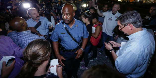 FERGUSON, UNITED STATES - AUGUST 18:  Captain Ron Johnson of the Missouri Highway Patrol speaks to media during a protest on