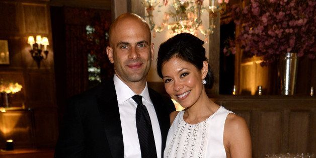 WASHINGTON, DC - MAY 03:  Sam Kass (L) and Alex Wagner attend the Bloomberg & Vanity Fair cocktail reception following the 20
