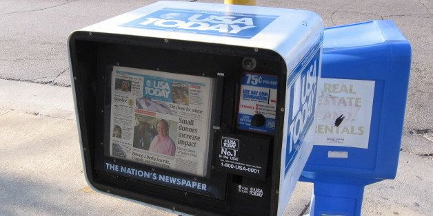 A photo of a USA Today newspaper vending box in Milwaukee.