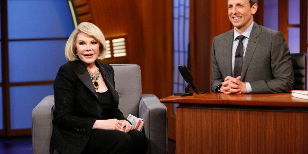 LATE NIGHT WITH SETH MEYERS -- Episode 081 -- Pictured: (l-r) Comeidan Joan Rivers during an interview with host Seth Meyers