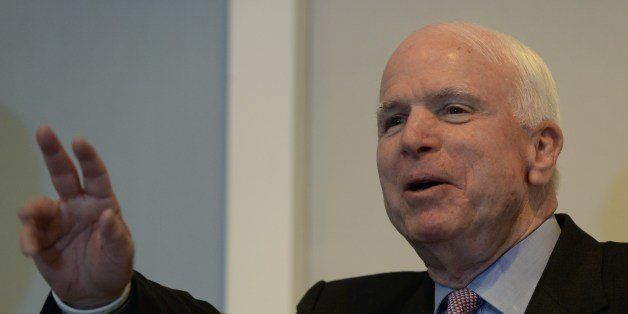 US senator John McCain takes questions  during a press conference held jointly with US senator Sheldon Whitehouse (not pictur