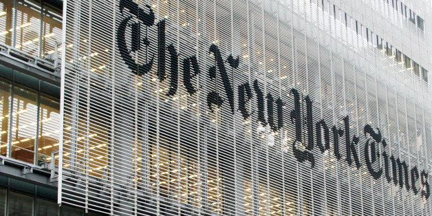 People pass the New York Times building in New York,  Wednesday, Oct. 10, 2012. The New York Times Co.'s stock rose on Thursd