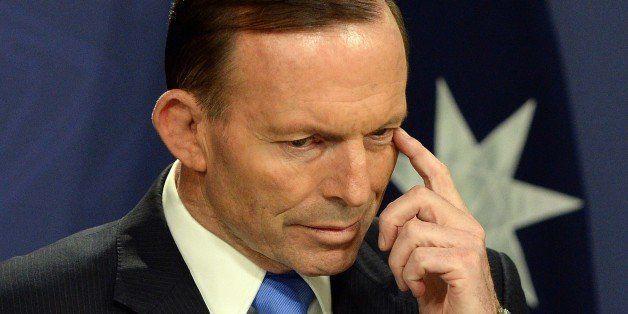 Australia's Prime Minister Tony Abbott gestures during a press conference in Sydney on September 19, 2014. Australia stepped