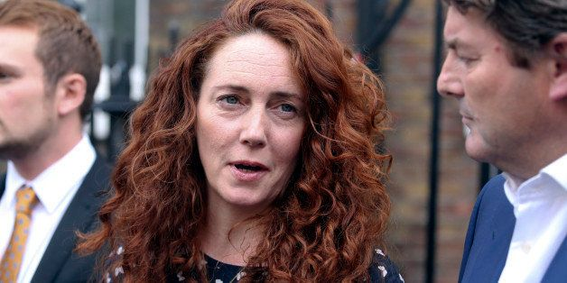 Rebekah Brooks, former chief executive officer of News International Ltd., center, speaks to the media in London, U.K., on Th