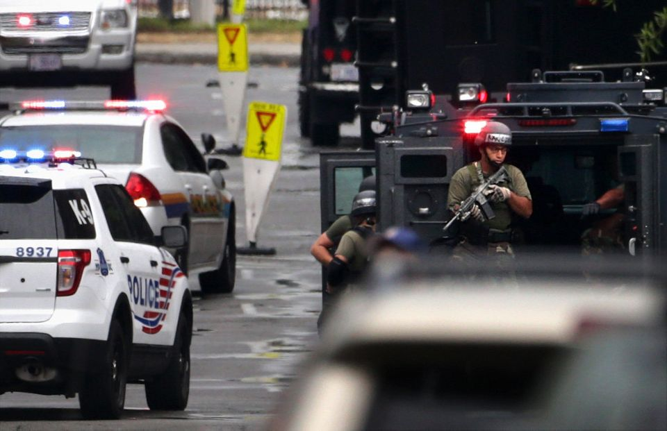 WASHINGTON, DC - SEPTEMBER 16:  Heavyly armed police officers  respond to a shooting at the Washington Navy Yard September 16
