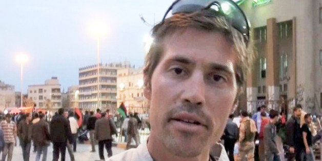 FILE - This undated file still image from video released April 7, 2011, by GlobalPost, shows James Foley of Rochester, N.H.,