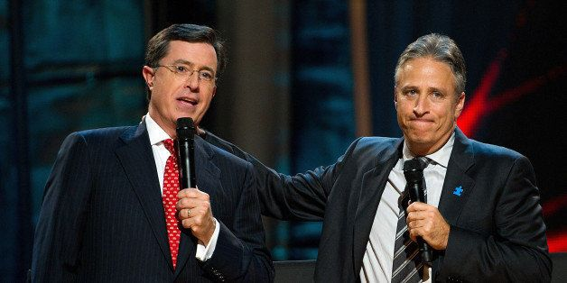 FILE - In this Oct. 2, 2010 file photo, Stephen Colbert, left, and Jon Stewart appear on stage at Comedy Central's  'Night Of