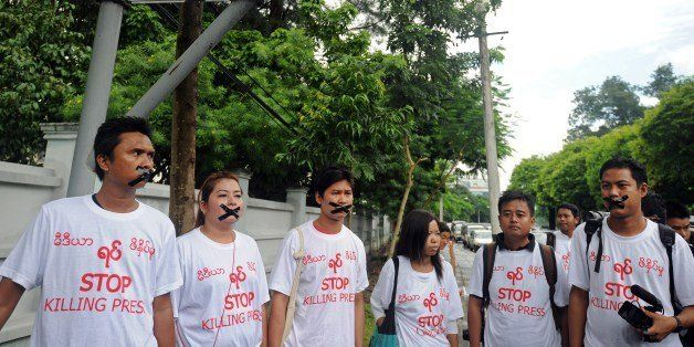 Myanmar journalists wearing T-shirts that say 'Stop Killing Press' stage a silent protest for five journalists who were jaile