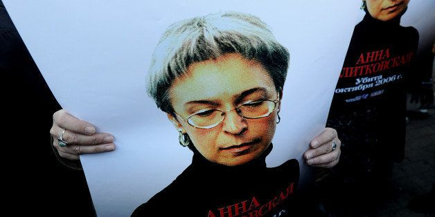 Russian human rights activists attend a rally in honour of slain Russian journalist Anna Politkovskaya in Moscow on October 7