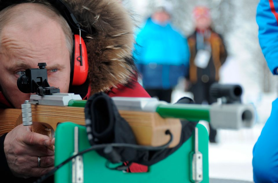 Russian Prime Minister and President-elect Vladimir Putin shoots with a rifle during the the para-Olympic biathlon championsh