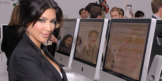NEW YORK - NOVEMBER 19:  TV personality Kim Kardashian shops on an eBay computer kiosk inside the eBay Holiday Store on Novem