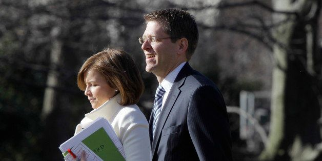 White House Press Secretary Jay Carney, who starts his new job today, walks with Deputy Chief of Staff Alyssa Mastromonaco on