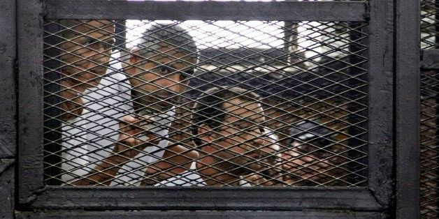 From left, Australian correspondent Peter Greste, Canadian-Egyptian acting bureau chief of Al-Jazeera Mohamed Fahmy, and Egyp