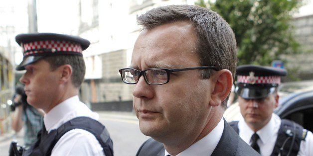 Andy Coulson, (C) a former top aide to British Prime Minister David Cameron, arrives at the Old Bailey in central London, ahe